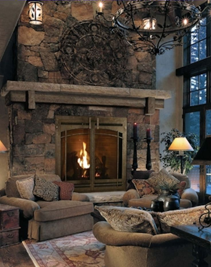 Stone Fireplace with mantle and hearth it's ok but I really like the  furniture sitting in