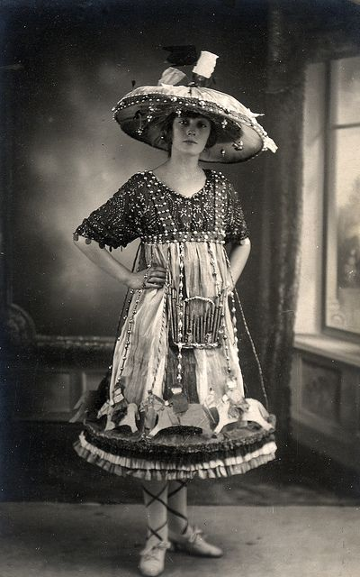 "Found image from Flickr fancy dress set: ""The woman is dressed as a carousel with horses dancing round her hem and an organ half way up her skirt. Her vast hat with lanterns on the top represents the roof."""