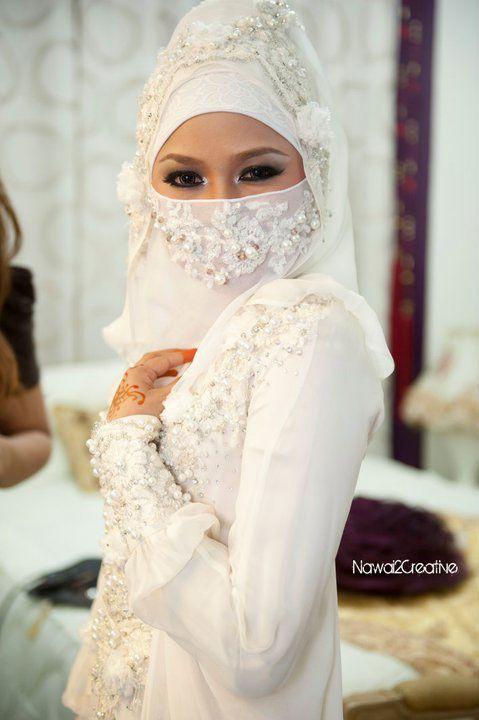 Hatta Dolmat of Malaysia exclusive Bridal Wear