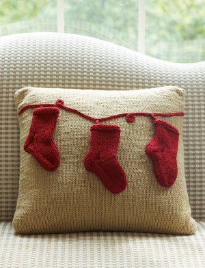 Looking to add a subtle pop of holiday cheer to a room in your home? This festive knit pillow pattern is the perfect way to incorporate a little Christmas spirit into your home without overpowering your year-round decor.