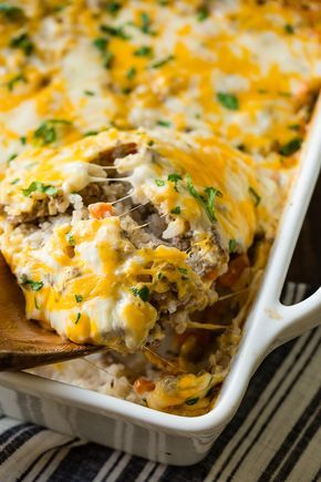 Our most popular recipe on our site, a quick and easy #dinnerrecipe idea that even picky eaters love, cheesy ground beef and rice #casserole! ohsweetbasil.com