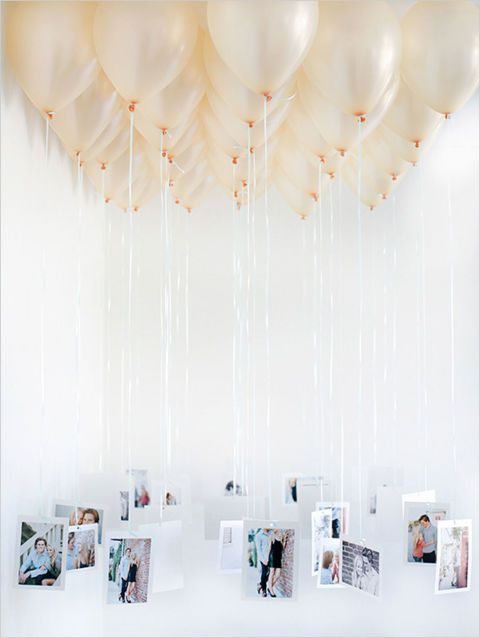 Rather than framing pictures as decorations, suspend them from balloons for a truly entrancing display. Get the tutorial at Wedding Chicks.