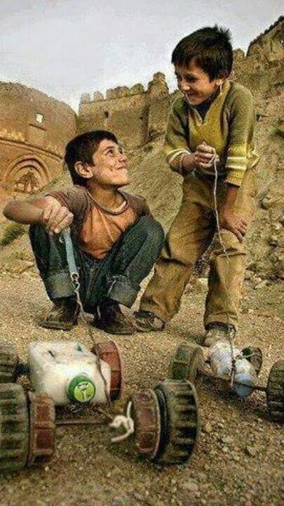 genuine smiles that can't be bought by money , innocent kurdish kids