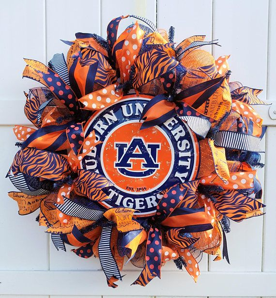"Auburn Wreath, Auburn Tigers Wreath by WhimsyWreathsDesigns  Proudly display your Tiger pride with this custom designed Auburn University wreath. This is a handmade deco mesh wreath with a metal ""Auburn University"" sign.   #auburn  (affiliate link)"