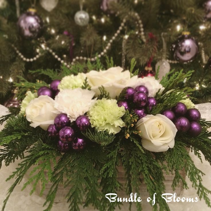 Any colour can creates holiday cheers.  Love this white, green and purple combination for Christmas.