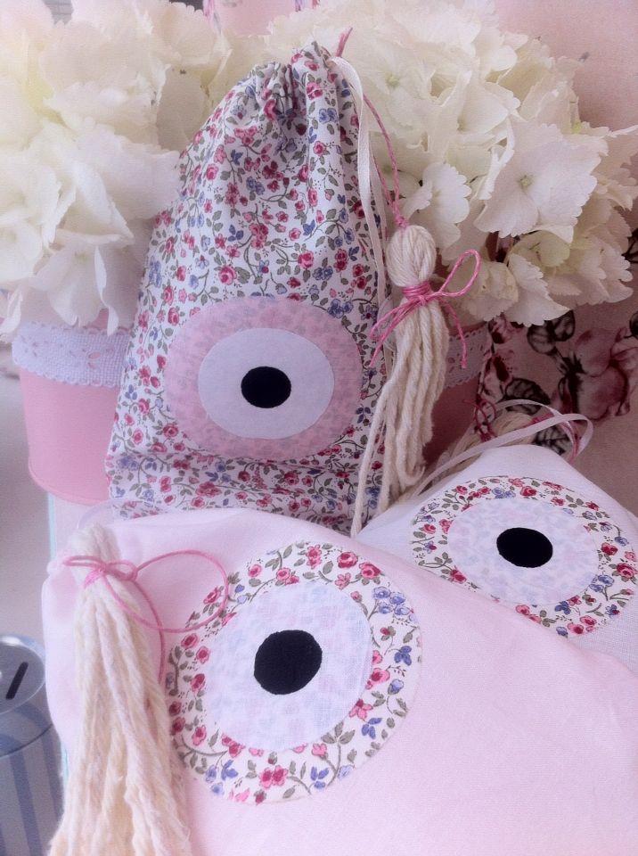 Πουγκάκια σε ροζ και floral με ματάκι