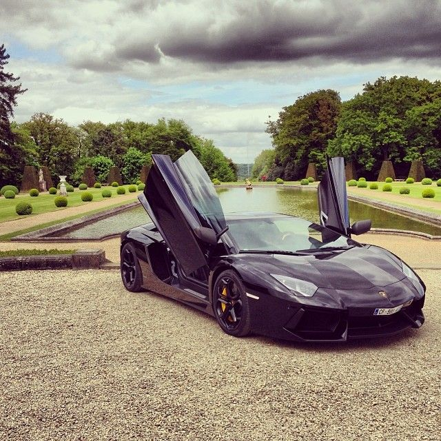 Black Lamborghini Aventador With The Suicide Doors Up