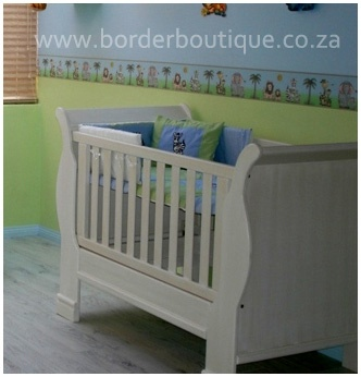 Nursery painted 2 tone - blue on top (sky effect) and lime green at the bottom (grass effect).    The paint line is recommended at 115cm from the floor.