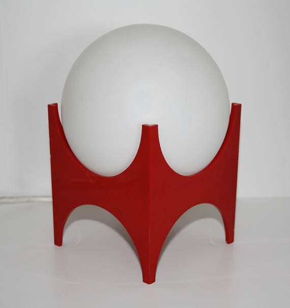 """Authentic cool 70s Iconic Lamp. Evocative of the space age, UFO era. Red Bakelite base and opal glass ball. Original wiring. Striking and unique looking. In very good condition. Height 18cm(7"""") - Width 15cm(6"""")  ✈ World Wide Shipping ✉ Brand New Stock, Updated regularly ✈ Safe and Secure Packaging ✉ Combined Shipping Prices For More Than One Item  Postage: Please be advised that we dont make money from postage. All postage rates listed are estimates based on the national postage company, An…"""