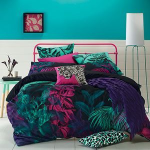 Create a tropical jungle theme with Amazon, a black cotton sateen design highlighted with a print of exotic flora in rich, jewel-like colours. This lush and colourful design is complemented by a printed green euro pillowcase and animal print cushion covers. Quilt cover has press stud closure and a plain black cotton sateen reverse.