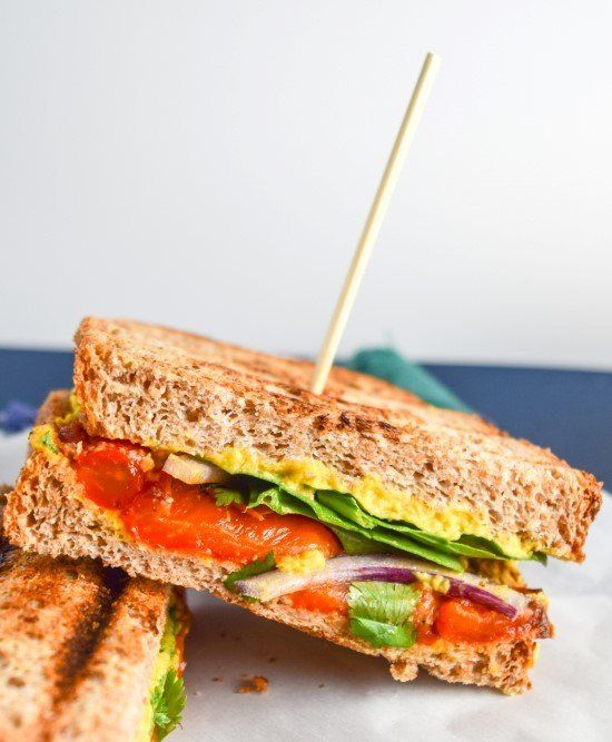 Tandoori roasted red pepper panini recipe with mango curry hummus, crisp fresh spinach, and nutty whole grain bread. An amazing vegan sandwich!