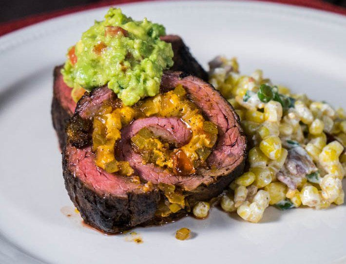 This Mexican Stuffed Skirt Steak is rubbed with a finger-licking spice mix and filled with tomato, bell peppers, onion and cheese.