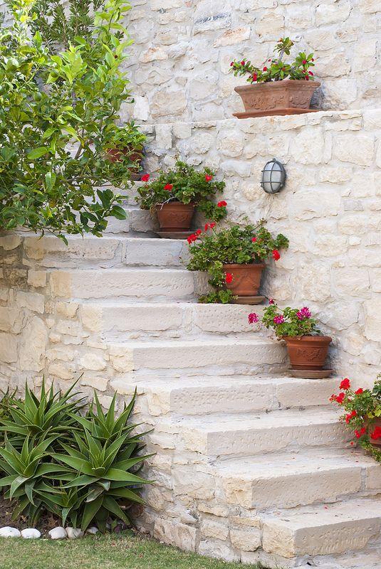 A Mediterranean garden in Crete - love the flowers on the stairs