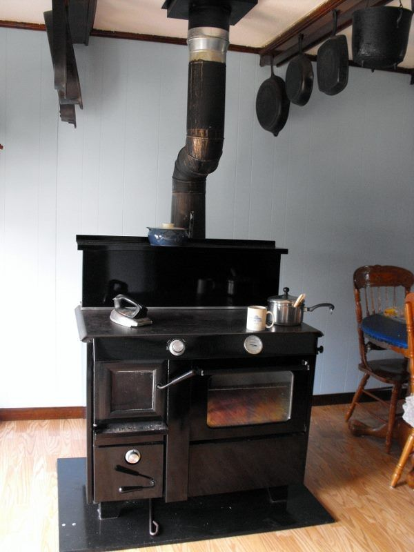 Amish - Wood burning cook stove with flat iron on top, frying pans hung  from ceiling rafter for storage - 129 Best Images About Wood Stoves On Pinterest Oven Cooker