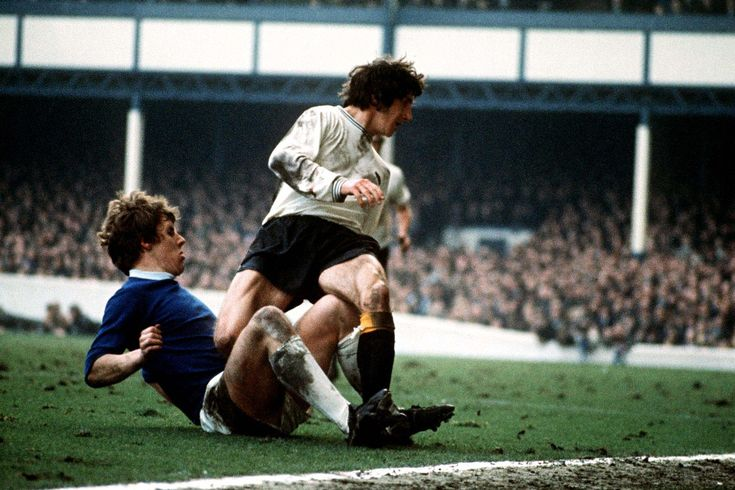 Joe Royle tackles Roy McFarland of Derby County