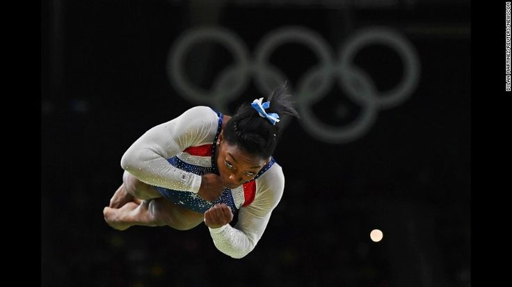 """US gymnast Simone Biles competes on the vault after <a href=""""http://www.cnn.com/2016/08/11/sport/simone-biles-usa-gymnastics-rio/index.html"""" target=""""_blank"""">winning Olympic gold in the individual all-around</a> on Thursday, August 11. Biles also won team gold earlier in the week."""