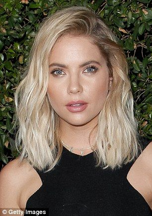 Pinky Little Liars!Ashley Bensondebuted her new pink locks while sitting courtside at th...