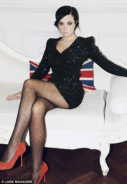 Fabulous. Sequin sleeved black dress, polka dot tights, color pop with red shoes.