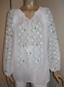 White and turquoise silk embroidery on a Romanian blouse