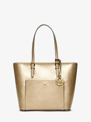 A tote that will stay in your accessories arsenal for seasons to come, the Jet Set tote is one of the must-haves behind our signature style. Crafted from shimmering metallic Saffiano leather, this design fastens with a top-zip closure and boasts a wealth of pockets, perfect for carrying all your essentials.