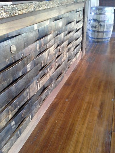 Bar front made from bourbon barrel staves. -- Gallery - Bourbon Barrel Rehab