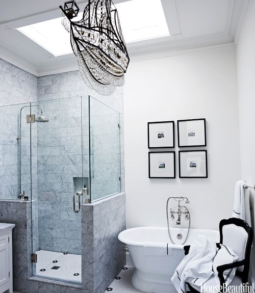 """The crystal ship chandelier """"was a whimsical last-minute selection,"""" says designer Ken Fulk about the master bath in a Victorian San Franciscan house.   - HouseBeautiful.com"""