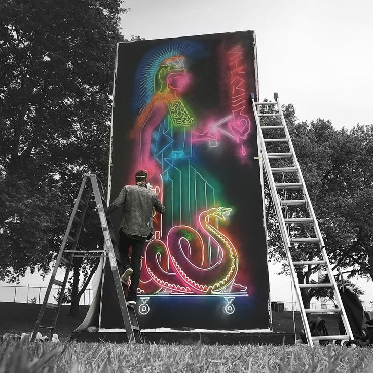 Perth artist STRAKER (@muralist) working at @GovBallNYC ready for this weekend's festival on Randall's Island.  #workinprogress #straker #neonart #governersball #icu_coloursplash