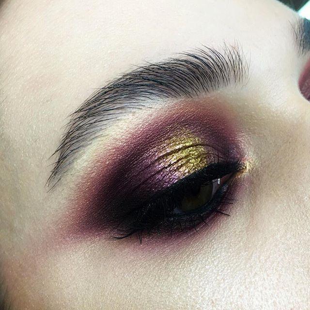 Aubergine and gold eyeshadow