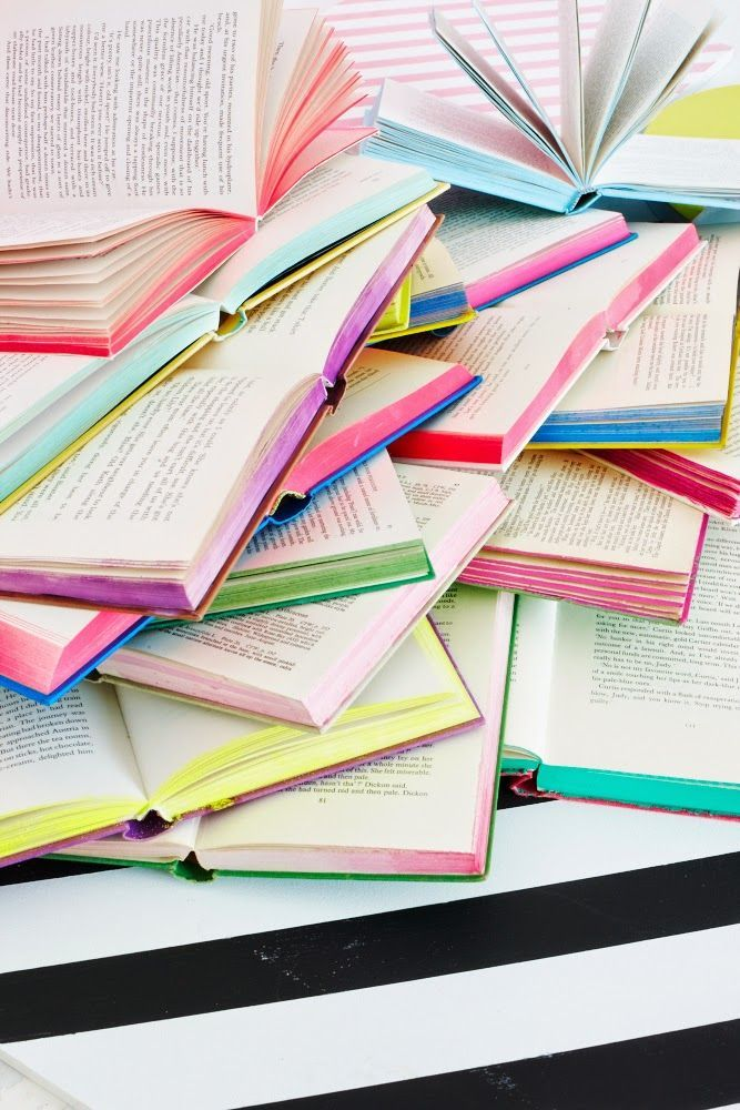 This stack of rainbow-edged books from Heart Home magazine makes us want to take a pack of highlighters to our own paperback collection. #DIY