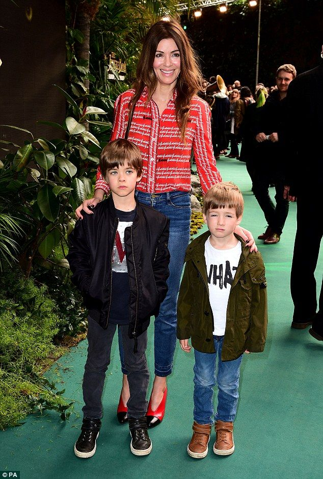 Family outing: Sara MacDonald brought her two sons along to The Jungle Book premiere at Lo...