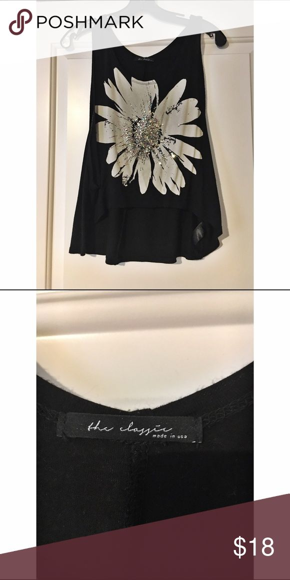 Sunflower tank top with open sides Size: small/medium Brand: the classic  Condition: very good Shipping: next business day!  ~Make offers ladies~  #sunflower #black #tanktop #sparkly #dressitupdressitdown #casual #theclassics #madeinusa #wearitwitleggings #brallete Tops Tank Tops