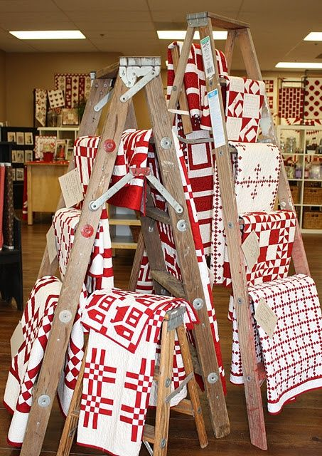 retail display of tablecloths   Ladders for quilts, blankets, knit blankets, lace tablecloths....