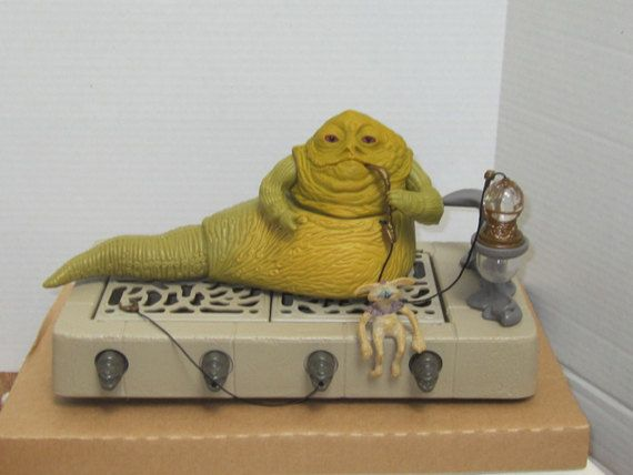 Star Wars Series Return of the Jedi Jabba the Hutt action playset. Jabba the Hutt sits on his throne and antagonizes his captives. His arms are