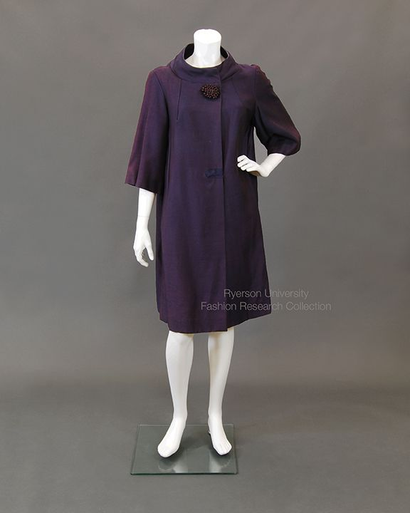 Shot taffeta blue/rose evening coat with moat collar, front pleats from collar, inset 3/4 sleeves, corded rose decorative button, snap front closure with placket. C. 1950. FRC 1988.02.024