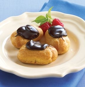 MINI ECLAIRS. Creamy delectable two-bite treats filled with a heavenly blend of sweet whipping cream & dairy custard. The rich pastry dough is topped with real bittersweet chocolate. Enjoy 12 pieces per box!    #mmmeatshops