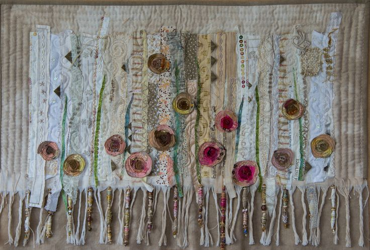Griet Lombard: Faded Roses I appliqued roses onto a background of vintage and other fabrics