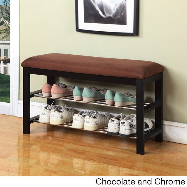 Composed of two metal shelves along with a plush microfiber top, this bench provides a convenient sitting area along with a convenient place for shoes. The base is made of a dark walnut wood and the bench top features plush microfiber top.