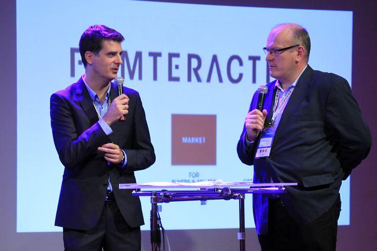 "Olgierd Cygan (Digital one) and Andrzej Garapich presenting ""Content marketing report – presentation of the results."""