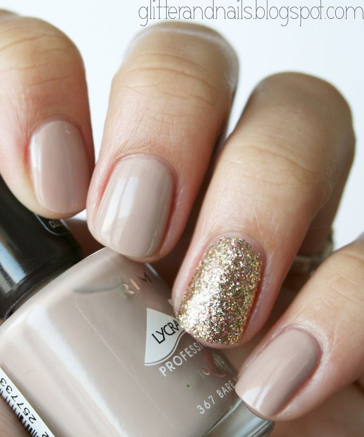 Nail Inspiration: Nude nails are a classic. Add a little edge and sparkle by painting an accent nail with gold glittered nail polish.