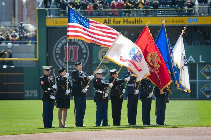 A joint service color guard presents the colors during the