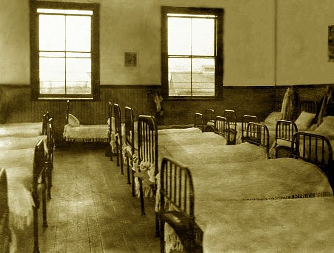 Dormitory, Coqualeetza Institute. Circa 1920. -  Government Policy allowed children to be taken from their parents at age 7 to attend residential school, but many were taken under the required age, some as young as 2 yrs. The parents were forced to relinquish any claim to their children.  Refusal would mean imprisonment.