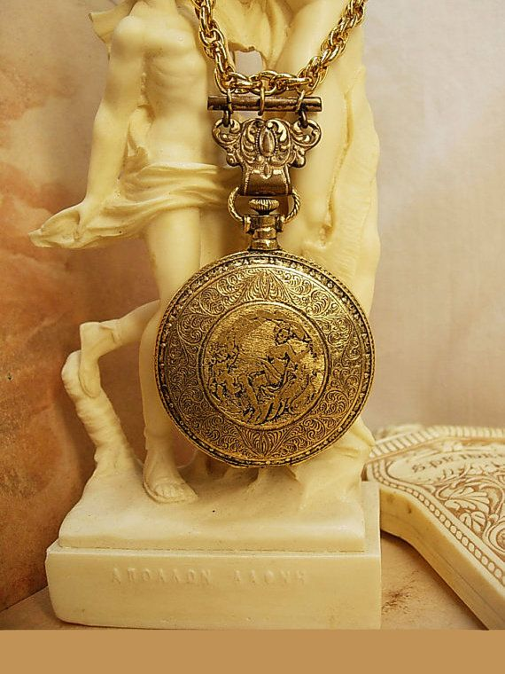 Vintage Nouveau pocketwatch compact necklace with raised nudes and antique hanger: