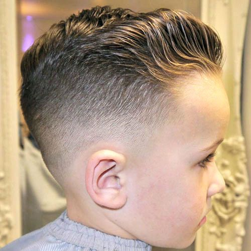 Low Bald Fade with Wavy Brushed Back Hair. 25 boy haircuts 2017