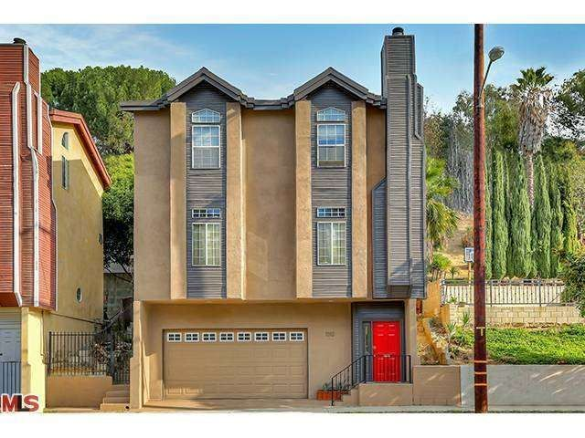 1312 El Paso Dr, Los Angeles, CA 90065 — A great value in fast-rising Glassell Park. This contemporary, multi-level home was built in 1991. High ceilings and large windows enhance the open floor plan that is abundant in natural light. The ground level features an entryway and attached two-car garage providing direct-access to the home. Second level living, dining and kitchen flow together beautifully and are warmed by a lovely fireplace. Two sets of sliding doors make for easy access to a…
