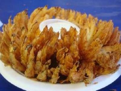A whole onion, coated with Dijon mustard and panko bread crumbs, then baked until extra crisp.