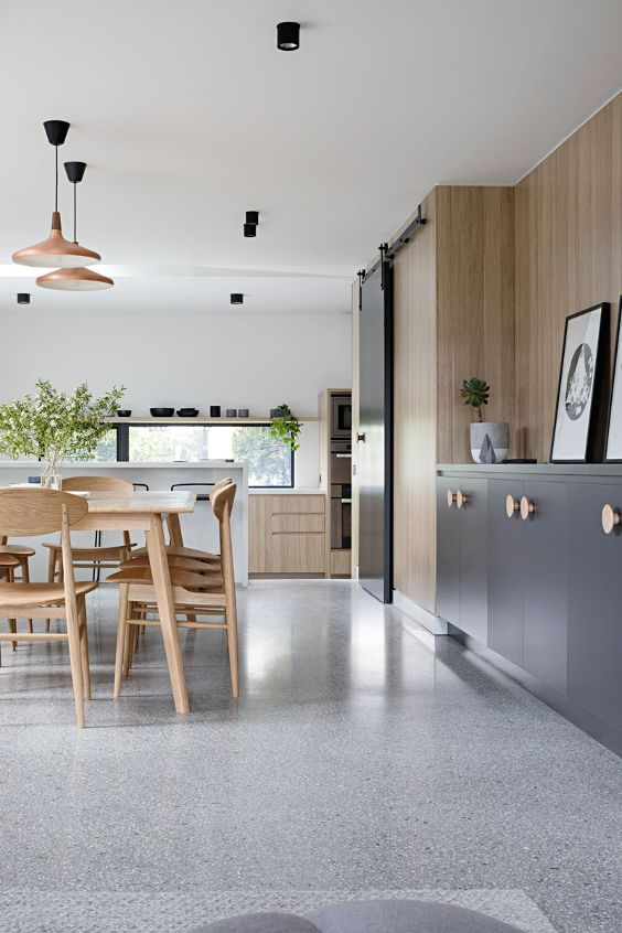 wood, terrazzo and tailor-made cabinets for a renovated brick house