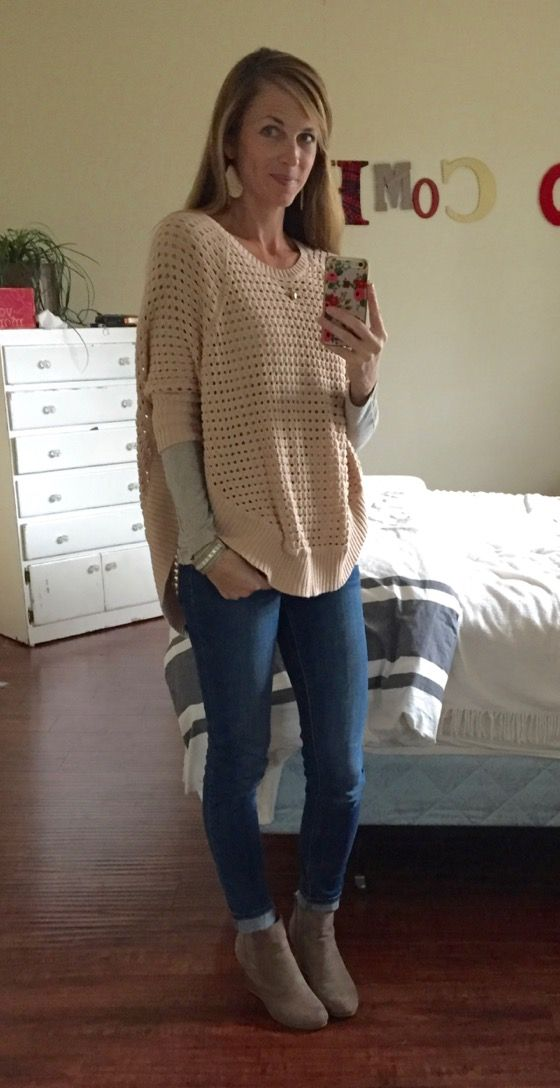 The sweater is SO cool - the style is different...I like how she styles it with the long sleeve underneath...and the hi-lo effect is great. Again, love this look with the fitted jeans.