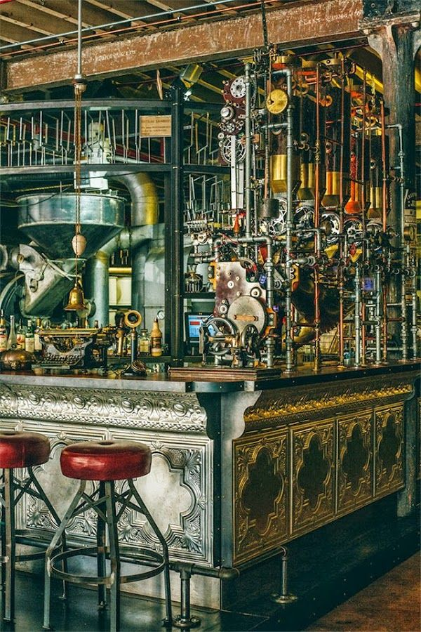 This is one of the Truth coffee shops in Cape Town, designed by Haldane Martin in a definite steampunk vein, featuring the cast iron vintage roaster drum in an industrial warehouse setting, with plenty of rugged gears, pipes and mechanisms thrown in for a good measure: