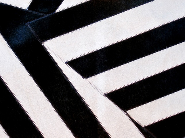 The Art Hide Vamos rug is fully designed in Australia and combines lustrous natural black and white premium cowhide together to create a unique statement piece.    Art Hide products are durable and easy to clean and come with a 12 month manufacturing warranty.    Item is bespoke made to order and offers free shipping. Rug image shows one area of pattern which is repeated for larger orders.