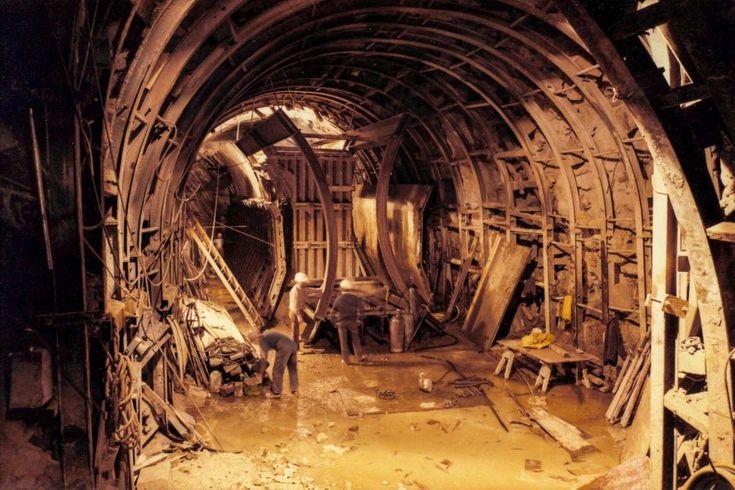Building the Melbourne Underground Rail Loop. Men work underground constructing curved walls